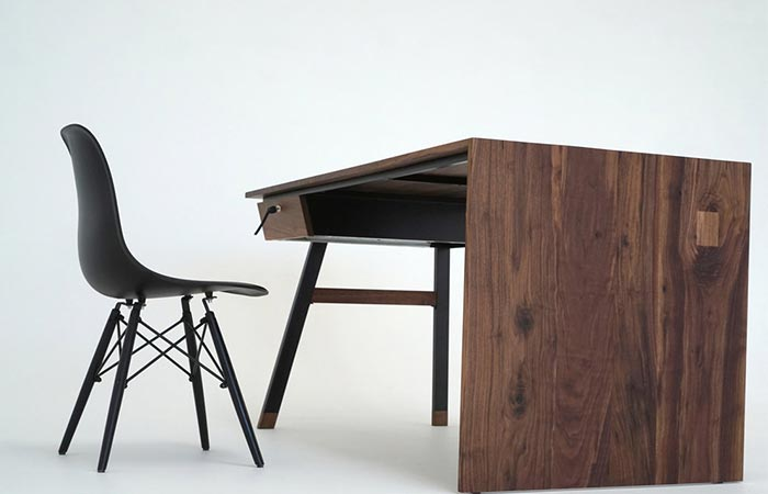 a wooden desk with a chair