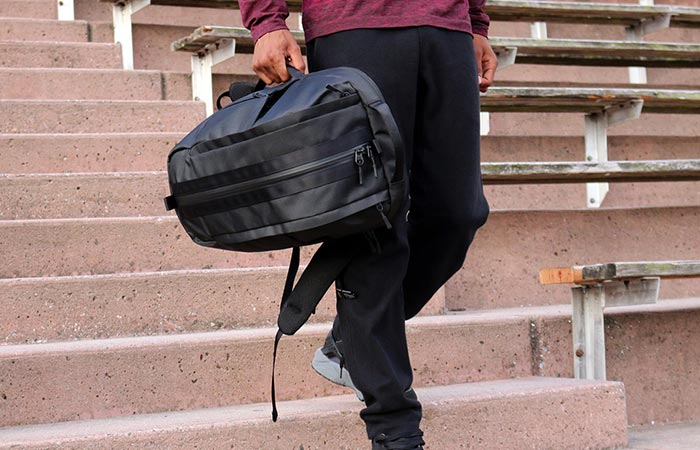 a guy carrying Aer Duffel Pack