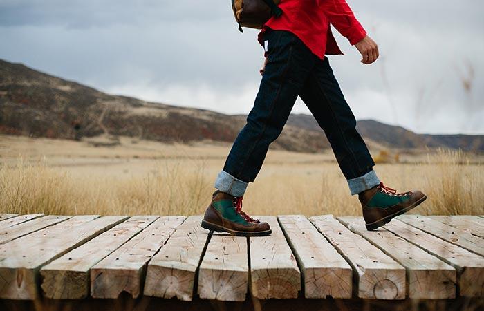 a guy walking on wooden deck