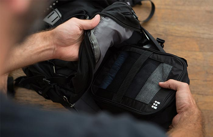 placing a packing bag inside a backpack