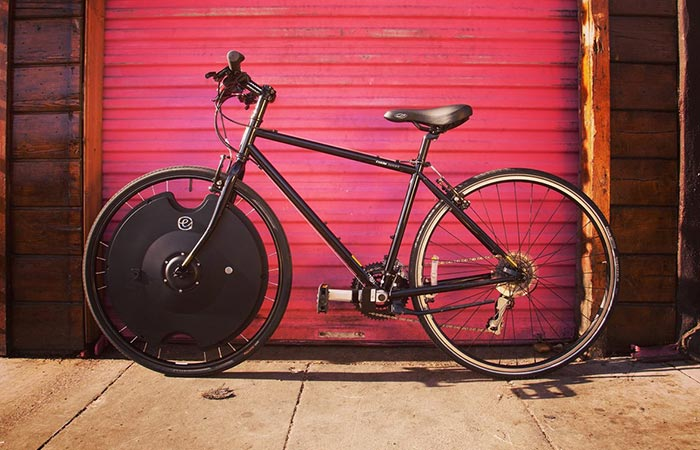 Bicycle with Electron Wheel in front of a red garage door