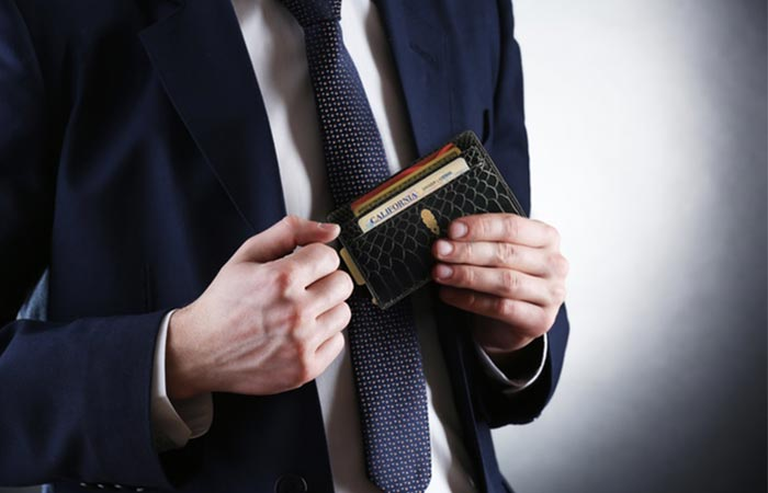 Man in suiting using the Inscribe Wallet