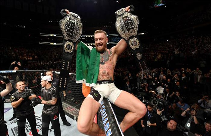 Conor McGregor holding the Featherweight and Lightweight world titles