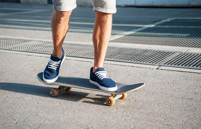 on a skateboard in blue Baabuk sneakers