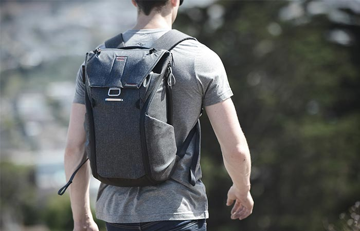 a guy wearing a grey backpack