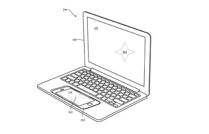Apple iPhone docked into the laptop