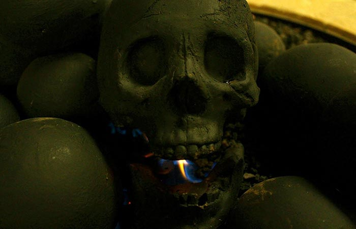 Flame burning inside the mouth of Skull Gas Fireplace Log