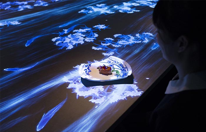 a food plate on a table covered with a light installation