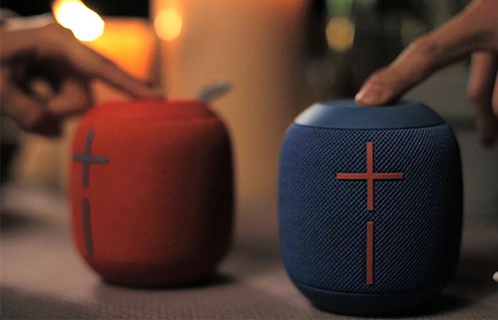 pressing the blue Wonderboom speaker