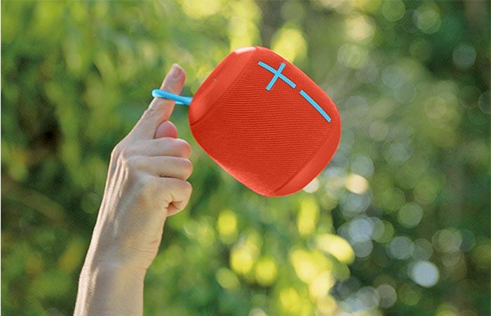 holding red Wonderboom speaker in air