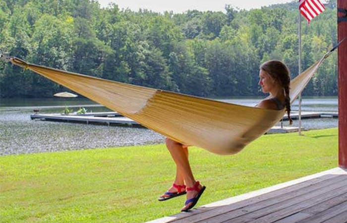 Girl using the Weatherproof Big Sur Hammock at a lake