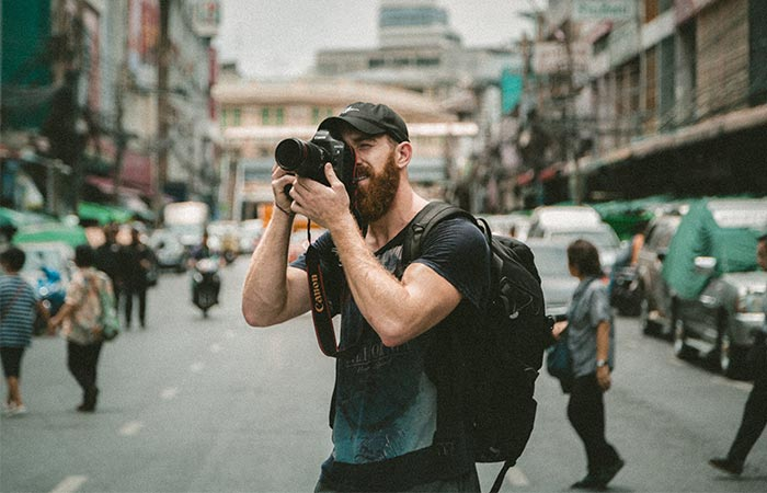 a guy taking a photo with a camera