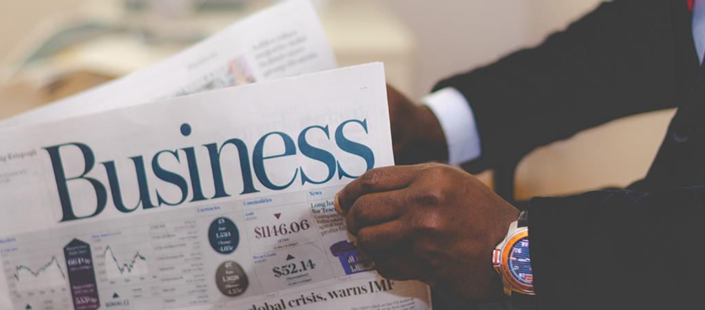 Man reading a business journal